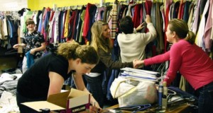 Volunteers organize clothing donations. Hope Faith Ministries started because several people wanted to serve.