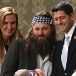 Duck Dynasty television show star Willie Robertson (C) and his wife Korie pose for a picture with U.S. Rep. Paul Ryan (R-WI) before the State of the Union speech at the U.S. Capitol in Washington Jan. 28, 2014