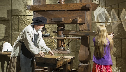 At the Passages Exhibit, visitors assist in the production of a Gutenberg Bible through a hands-on display.