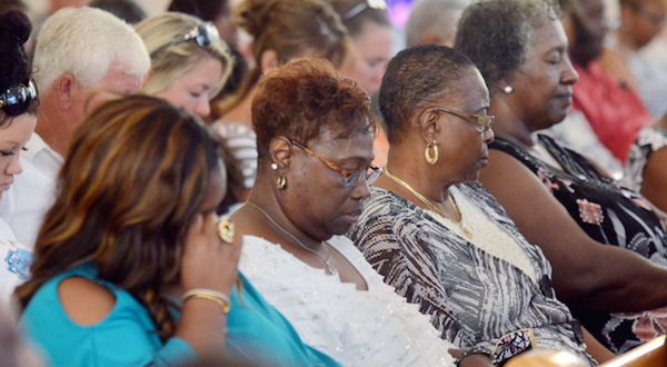 Sunday service attendees at Emanuel A.M.E. Church in Charleston, S.C. mourned the loss of their beloved pastor and other church members.