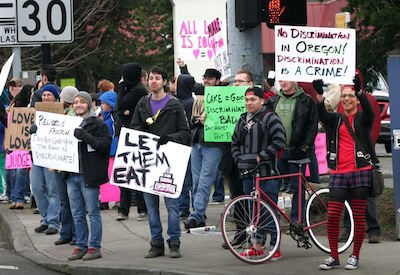 Activists protest against the Kleins outside the Sweet Cakes shop.