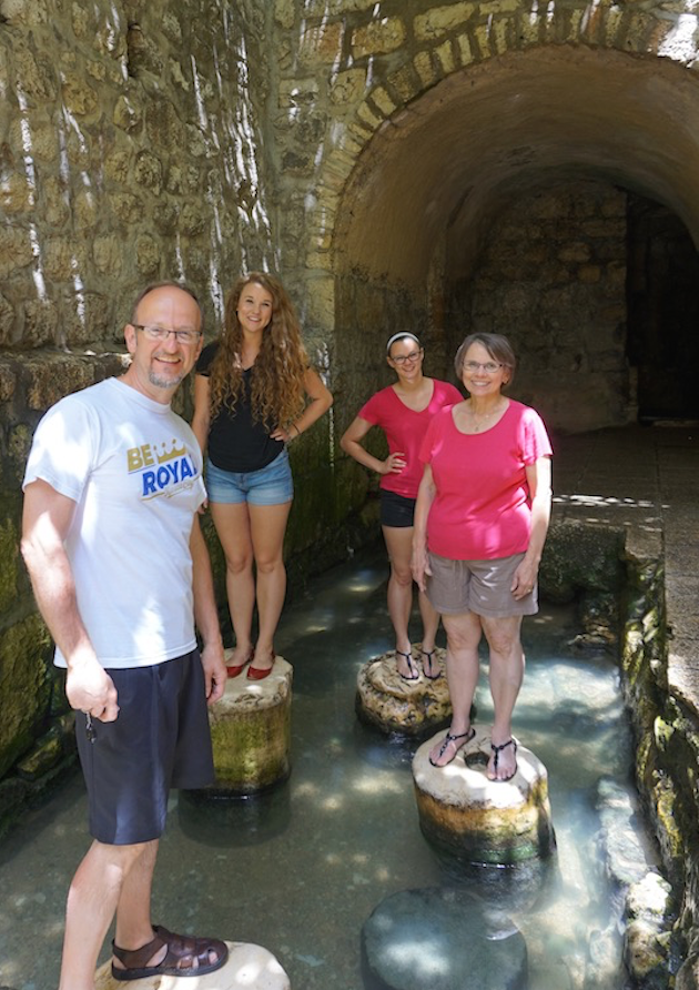 After ending your adventure walking underground through knee-deep water in Hezekiaih's tunnel, you can stand on Roman columns. It is the perfect setting for a family photo!