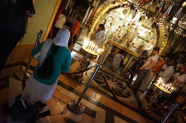 Pilgrims from around the world trek to the Church of the Holy Sepulchre. It is revered by Catholics, evidenced by long lines of people waiting to touch the rock tradition says the cross was inserted into.