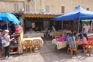 Aladdin's Restaurant in Caesarea is in a busy courtyard frequented by many tourists and locals looking for good food. Here Fade sells ice cream under a blue tent.
