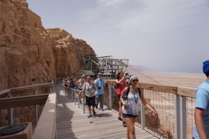 Exiting the tram with other tourists and Israeli students. Visitors can also hike up the mountainside though, in the summer, the temps may hit 114 in the shade.