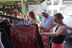 Emma and Hannah help our guide Moshe pick up a pair of lounge pants for his daughter.