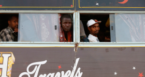 Men look out the windows of a bus as it travels to Nairobi, in Mandera town at the Kenya-Somalia border, on Dec. 6, 2014. Photo courtesy of REUTERS/Goran Tomasevic