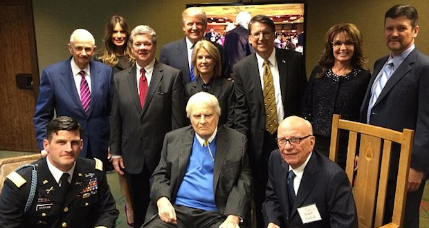 Friends from all over: Billy Graham (seated center) poses with a number of people including Melania and Donand Trump (back left), Sarah and Todd Palin (right) and Rupert Murdoch (bottom right). Trump was invited to sit a the table with Graham during the banquet honoring the preacher.