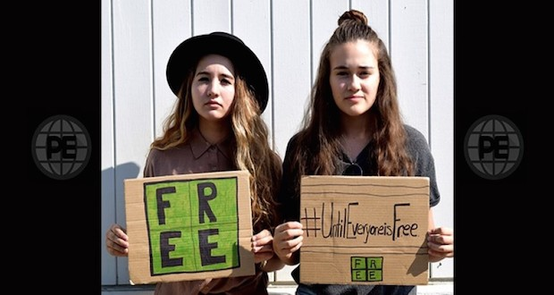Youth hold signs highlightng F.R.E.E