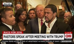 Donald Trump (middle) meets the press with prominent black pastors after a meeting in New York.