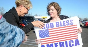 Pittsburg, Kan. residents get their free signs to display after atheists successfully force the local  Post Office to remove a 9/11 banner.