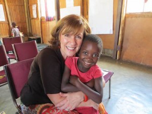 Becky with one of the Swazi orphans who have now found love and safety.