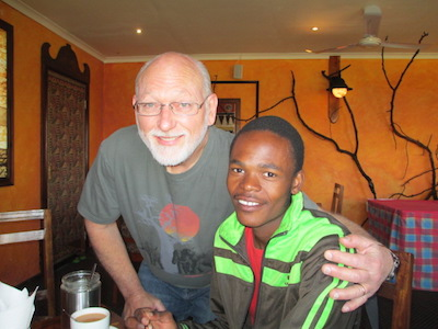 Tracy with a young Swazi man who now has a brighter future.