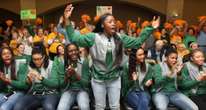 Baylor University's Alexis Jones reacts with her teammates during the women's NCAA college basketball tournament selection show in Waco, Texas.