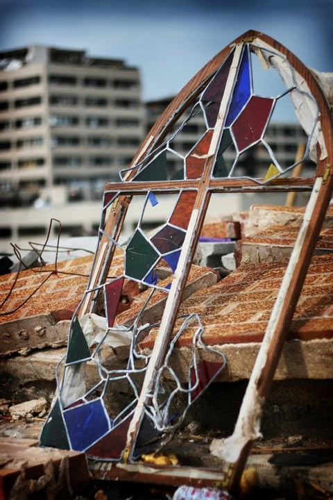 The Stained Glass Theater in Joplin lay flattened with both survivors and victims in its rubble.