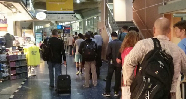 At Kansas City International Airport, travelers must pass through security which is set up for every three gates. Lines and waits can be long.  Photo: Dwight Widaman, Metro Voice News