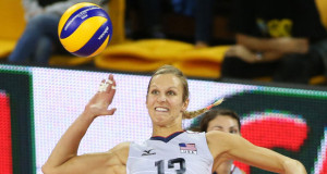 U.S. team captain Christa Harmotto Dietzen spikes volleyball during game with Turkey. Photo courtesy of FIVB