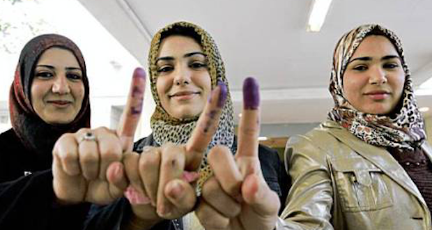 Young Afghani women show the proof they voted–a purple finger tip. Will American Christians not exercise the right American soldiers fought and died to give Afghanistan?