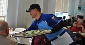 Former Royals pitcher Jeremy Guthrie serves food at City Union Mission at a past event.