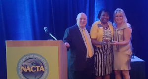 Senora Kelly, center, receives the 2016 honor.