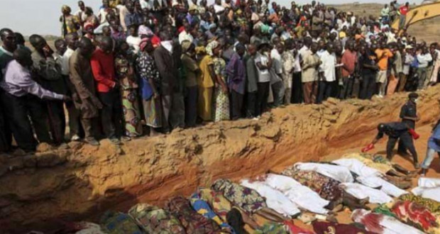 Nigerian Christians bury murdered church members. There were too many for individual graves so a mass grave was used.
