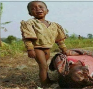 A child stands over his dead Nigerian Christian mother after their village was attacked.