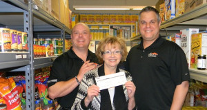 Left to right – Blake Clarkson, Owner Integrity Roofing; Janet Lowe, Ex. Dir. of Hope Network; David Todd, Owner of Integrity Roofing) they are standing in the Vision of Hope Food Pantry.